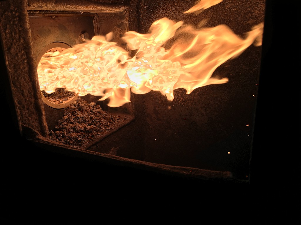 The burner flame from plant and wood pellets